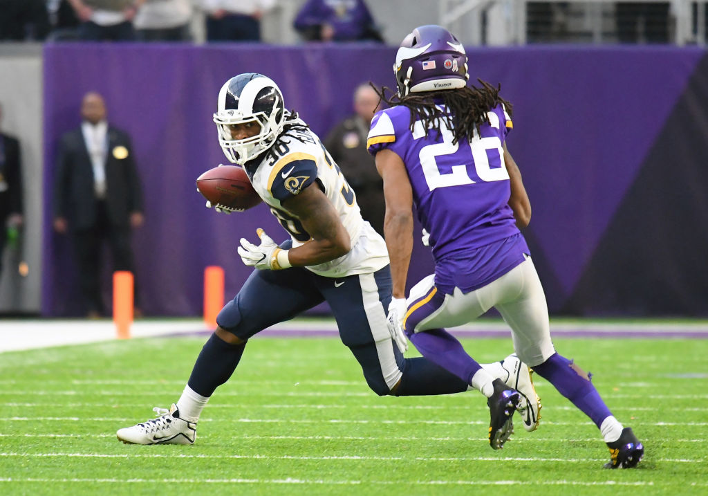 MINNEAPOLIS, MN - NOVEMBER 19: Los Angeles Rams Running Back Todd Gurley II (30) runs with the ball as Minnesota Vikings cornerback Trae Waynes (26) gives chase during a NFL game between the Minnesota Vikings and Los Angeles Rams on November 19, 2017 at U.S. Bank Stadium in Minneapolis, MN. (Photo by Nick Wosika/Icon Sportswire via Getty Images)