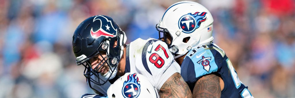 NASHVILLE, TN - DECEMBER 3:  C.J. Fiedorowicz #87 of the Houston Texans is tackled by Kevin Byard #31 and Avery Williamson #54 of the Tennessee Titans at Nissan Stadium on December 3, 2017 in Nashville, Tennessee.  The Titans defeated the Texans 23-14.  (Photo by Wesley Hitt/Getty Images)
