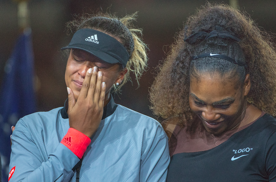 Serena Williams consoling 2018 US Open champion Naomi Osaka (left) after their match, September 8, 2018. (Photo by Tim Clayton/Corbis via Getty Images)