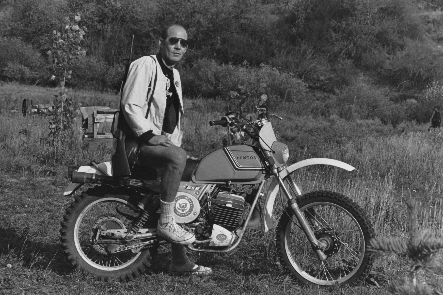 Journalist Hunter S. Thompson sits on his Penton Motor Cycle with his rifle over his shoulder on his ranch circa 1976 near Aspen Colorado. A collection of letters written by Thompson will go up for auction this week. (Photo by Michael Ochs Archives/GettyImages)