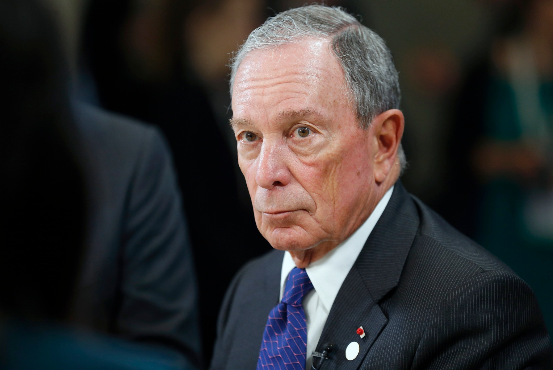 """Special envoy to the United Nations for climate change Michael Bloomberg speaks to a journalist during the One Planet Summit at the Seine Musicale on the Ile Sequin on December 12 in Boulogne-Billancourt, France. Around 50 world leaders and environmental activists are taking part in a major climate summit in Paris called """"One Planet Summit"""" two years after Paris Agreement Cop 21.  (Photo by Chesnot/Getty Images)"""