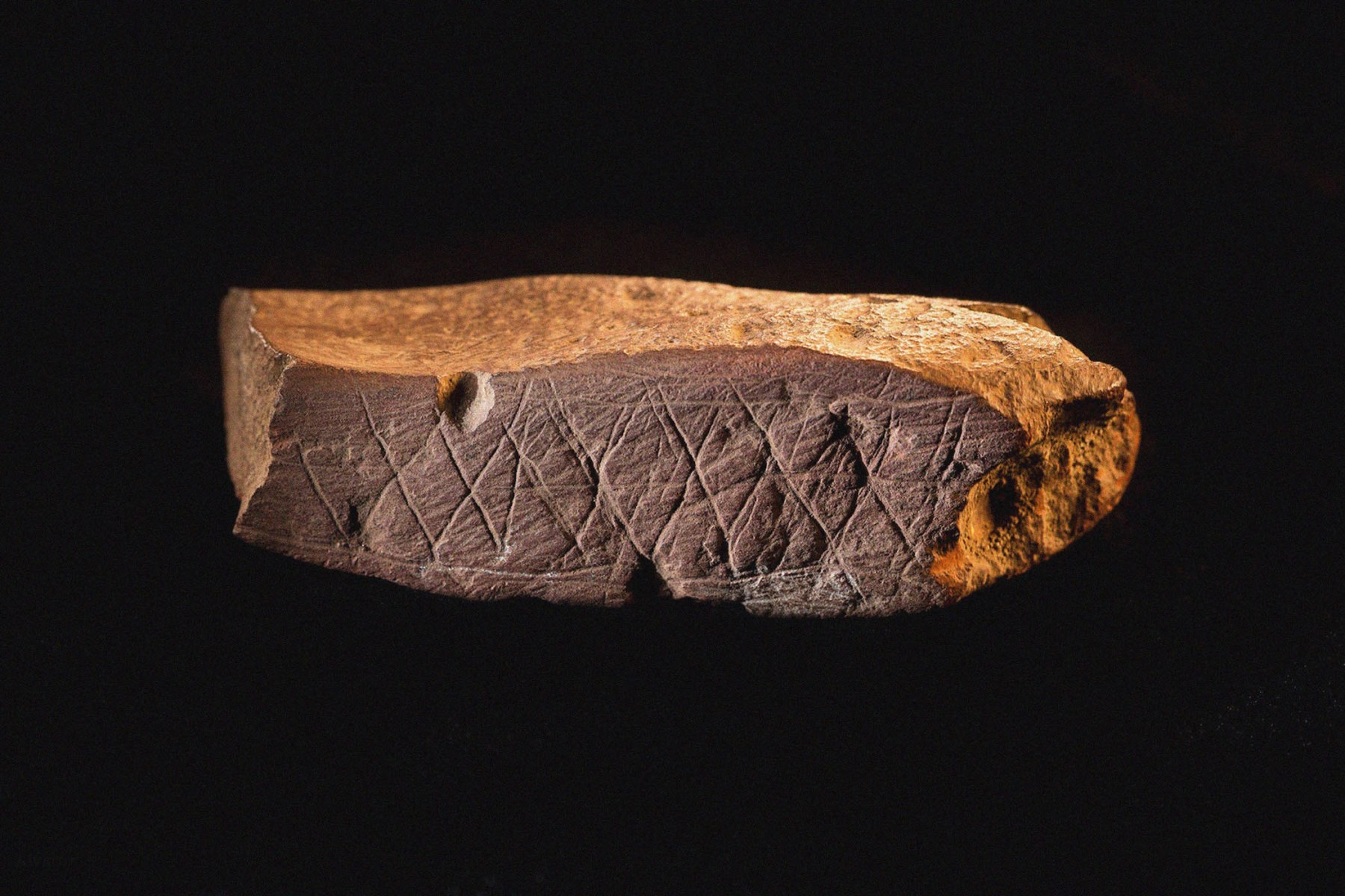 Engraved Ocher Plaque from Blombos Cave, South Africa. The oldest artifact of mankind, 70th millennium BC. Found in the collection of Smithsonian Institution Archives. (Photo by Fine Art Images/Heritage Images/Getty Images)