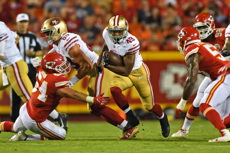 KANSAS CITY, MO - AUGUST 11: Running back Matt Breida #49 of the San Francisco 49ers rushes against the Kansas City Chiefs during the second half of a preseason game on August 11, 2017 at Arrowhead Stadium in Kansas City, Missouri. (Photo by Peter G. Aiken/Getty Images)
