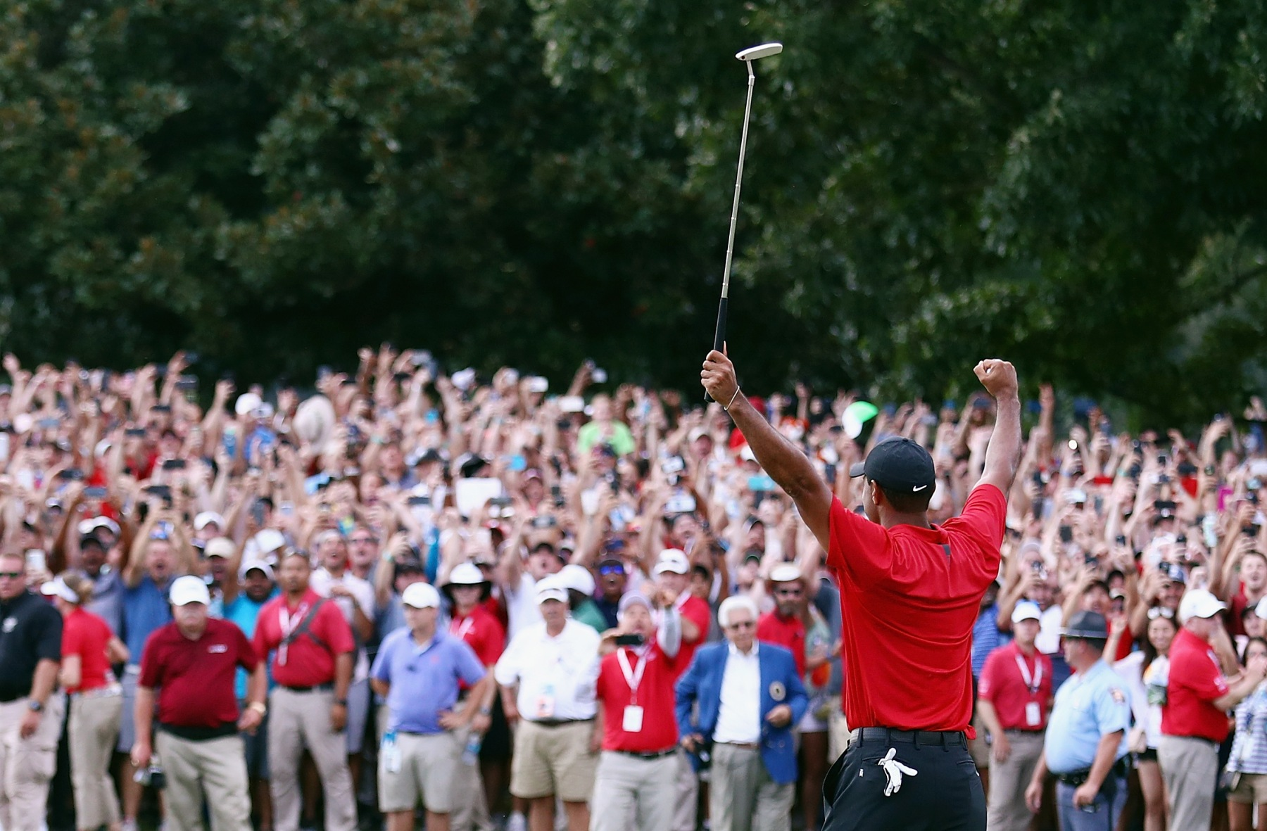 3358a584e8206 Tiger Woods of the United States celebrates making a par on the 18th green  to win