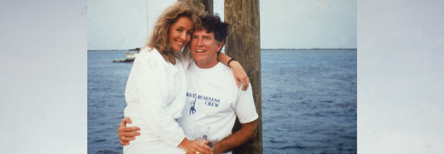 American politician Gary Hart sits on a dock with Donna Rice on his lap, 1987. (Photo by National Enquirer/Getty Images)