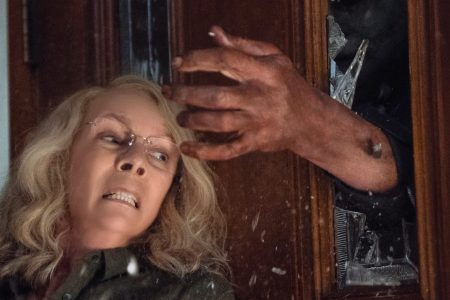 """Laurie Strode (Jamie Lee Curtis) barricades herself inside her home (to no avail) in """"Halloween."""" Curtis returns to her iconic role as Laurie Strode, who comes to her final confrontation with Michael Myers, the masked figure who has haunted her since she narrowly escaped his killing spree on Halloween night four decades ago. UNIVERSAL"""