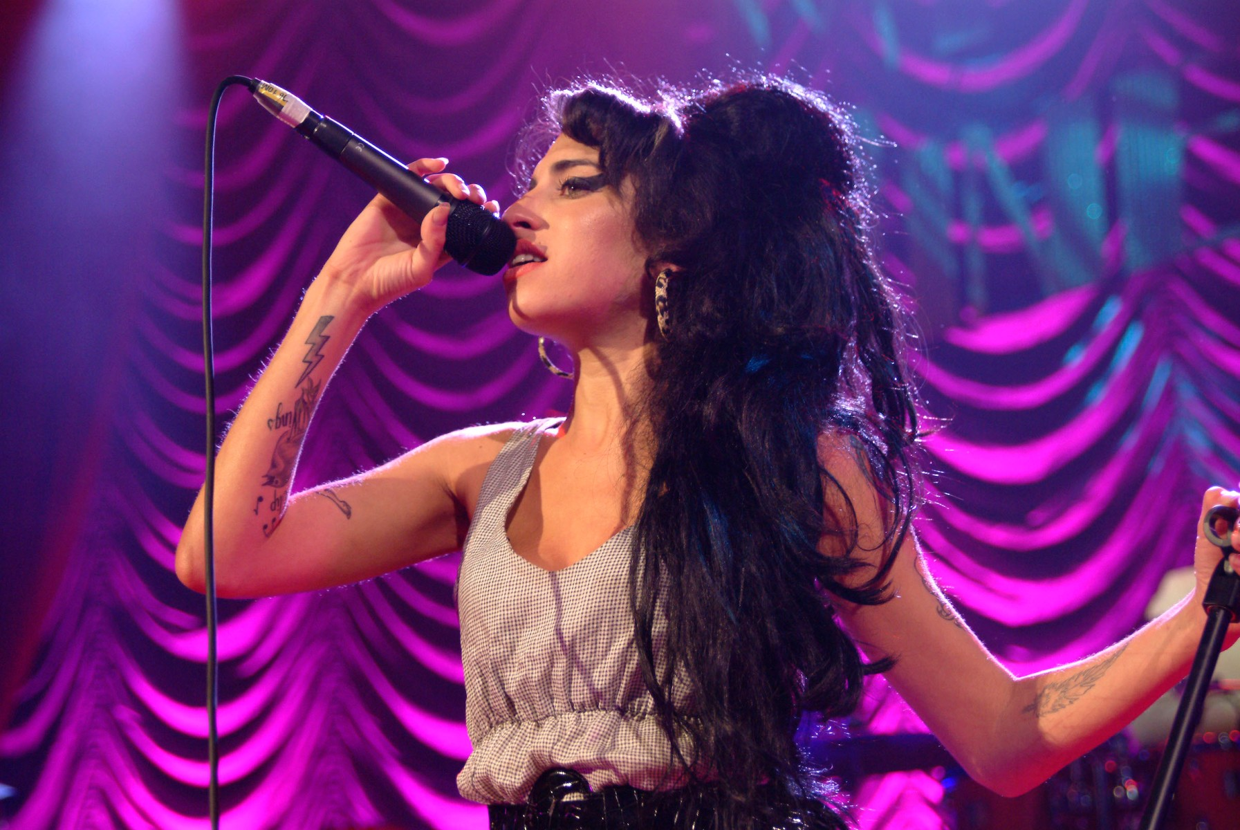 Photo of Amy Winehouse, performing live on stage. A hologram of Winehouse will soon go on tour. (Photo by C Brandon/Redferns/Getty Images)