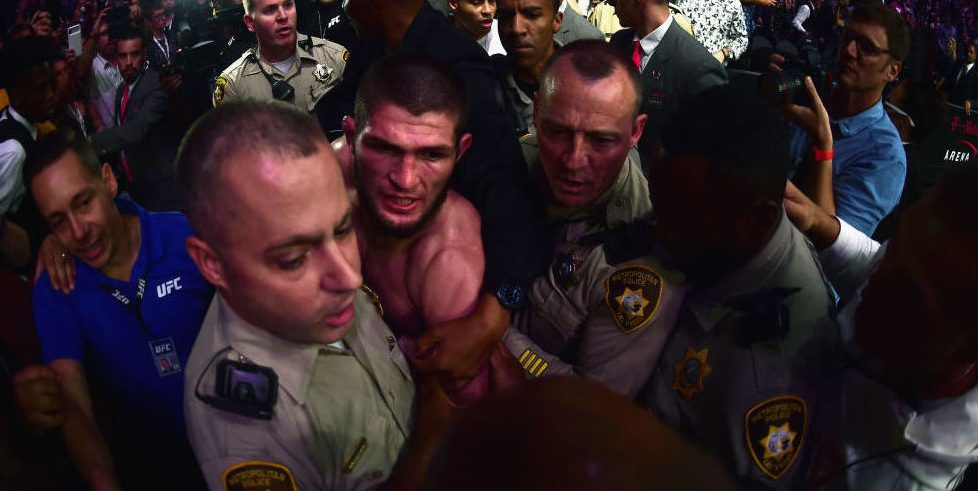 After defeating Conor McGregor at UFC 229, Khabib Nurmagomedov is escorted by Las Vegas police from the T-Mobile Arena after a post-fight melee that involved numerous scuffles inside and outside the octagon. (Photo credit: Harry How/Getty Images)