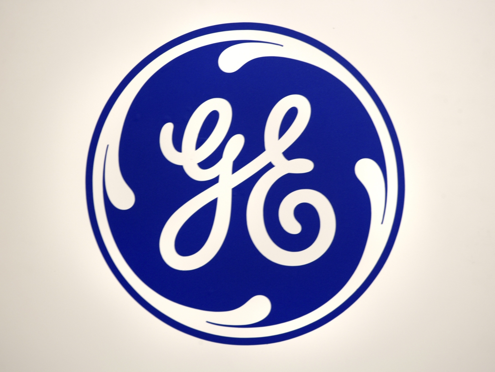 Logo of General Electric GE.  GE recently announced that it would be replacing current CEO John Flannery with H. Lawrence Culp. (Photo by Ulrich Baumgarten via Getty Images)
