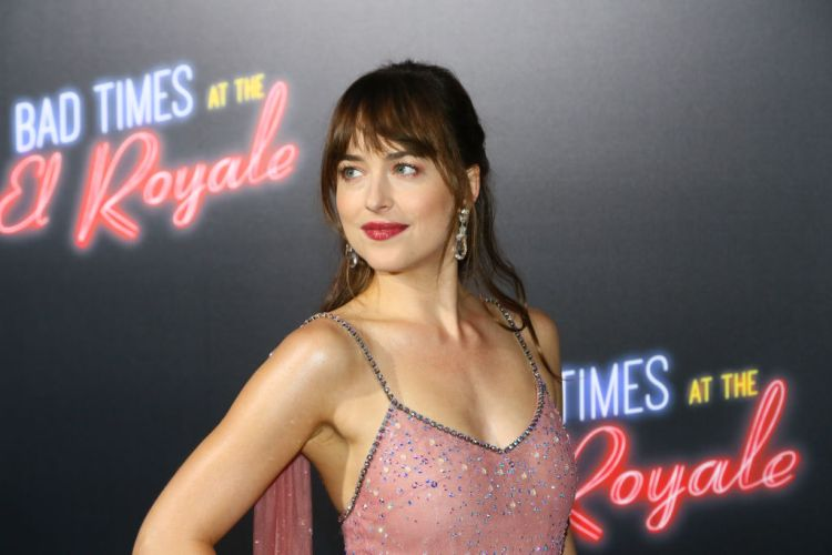"HOLLYWOOD, CA - SEPTEMBER 22:  Dakota Johnson arrives to the premiere of 20th Century FOX's ""Bad Times At The El Royale"" at TCL Chinese Theatre on September 22, 2018 in Hollywood, California.  (Photo by Gabriel Olsen/WireImage)"