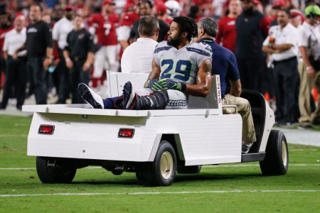 Seattle Seahawks defensive back Earl Thomas (29) is carted off the field after being injured during the NFL football game between the Seattle Seahawks and the Arizona Cardinals on September 30, 2018 at State Farm Stadium in Glendale, Arizona. (Photo by Kevin Abele/Icon Sportswire via Getty Images)