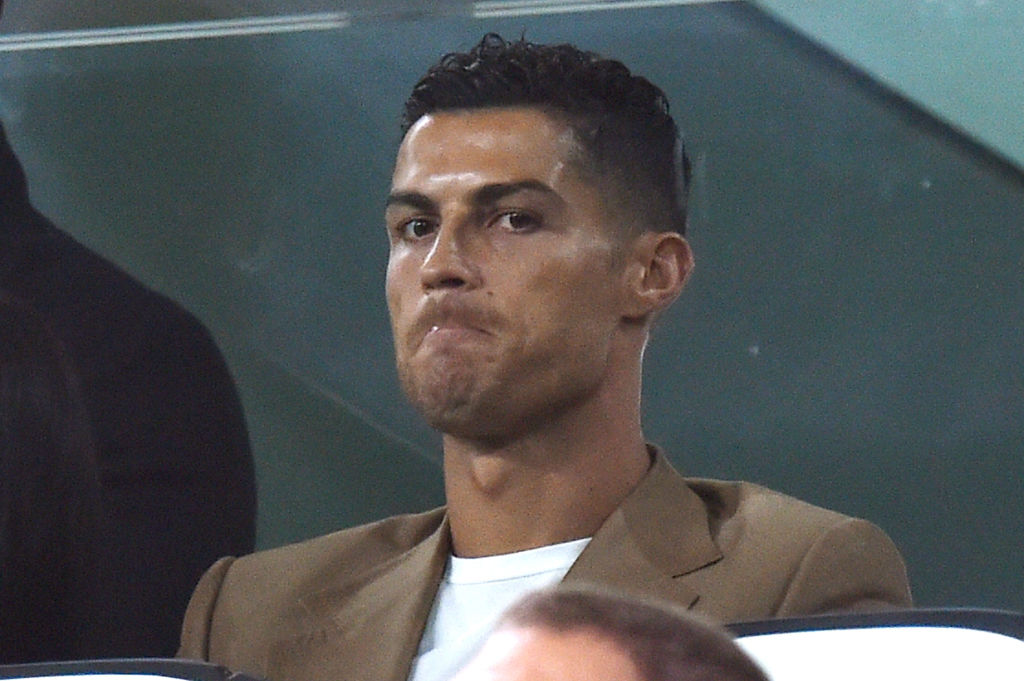 TURIN, ITALY - OCTOBER 02:  Cristiano Ronaldo of Juventus looks on in VIP standing during the Group H match of the UEFA Champions League between Juventus and BSC Young Boys at Allianz Stadium on October 2, 2018 in Turin, Italy.  (Photo by Tullio Puglia - UEFA/UEFA via Getty Images)