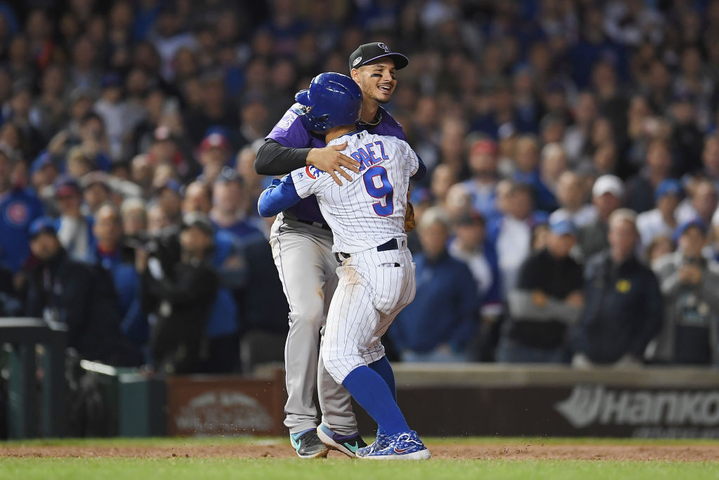 CHICAGO, IL - OCTOBER 02:  Javier Baez #9 of the Chicago Cubs hugs Nolan Arenado #28 of the Colorado Rockies in the eleventh inning during the National League Wild Card Game at Wrigley Field on October 2, 2018 in Chicago, Illinois.  (Photo by Stacy Revere/Getty Images)