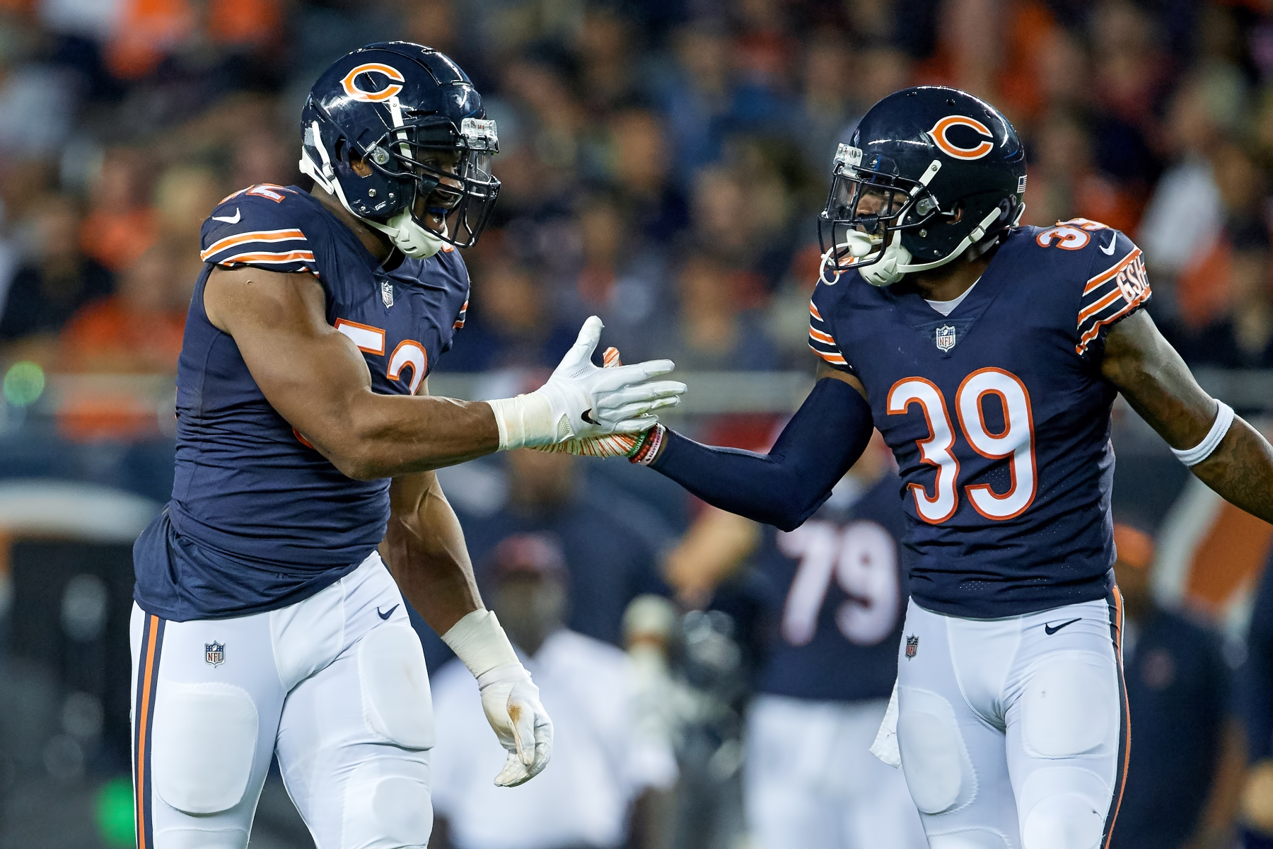 CHICAGO, IL - SEPTEMBER 17: Chicago Bears linebacker Khalil Mack (52) celebrates with Chicago Bears defensive back Eddie Jackson (39) after a play in game action during an NFL game between the Chicago Bears and the Seattle Seahawks on September 17, 2018 at Soldier Field in Chicago, Illinois. (Photo by Robin Alam/Icon Sportswire via Getty Images)