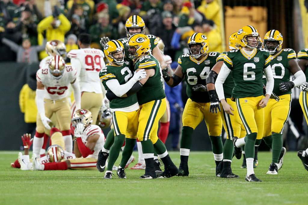 Mason Crosby #2 of the Green Bay Packers celebrates with teammates after kicking a field goal to beat the San Francisco 49ers 33-30 at Lambeau Field on October 15, 2018 in Green Bay, Wisconsin. (Photo by Dylan Buell/Getty Images)
