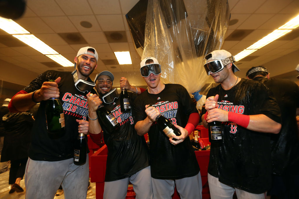 NEW YORK, NEW YORK - OCTOBER 09:  J.D. Martinez #28, Mookie Betts #50, Brock Holt #12 and Andrew Benintendi #16 of the Boston Red Sox celebrate in the locker room with his team after defeating the New York Yankees to win Game Four American League Division Series by a score of 4-3 at Yankee Stadium on October 09, 2018 in the Bronx borough of New York City. (Photo by Elsa/Getty Images)