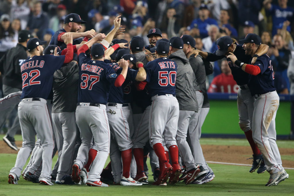 Members of the Boston Red Sox celebrate after the final out in the ninth inning to defeat the Los Angeles Dodgers in Game 5 of the 2018 World Series at Dodger Stadium on Sunday, October 28, 2018 in Los Angeles, California. (Photo by Rob Leiter/MLB Photos via Getty Images)