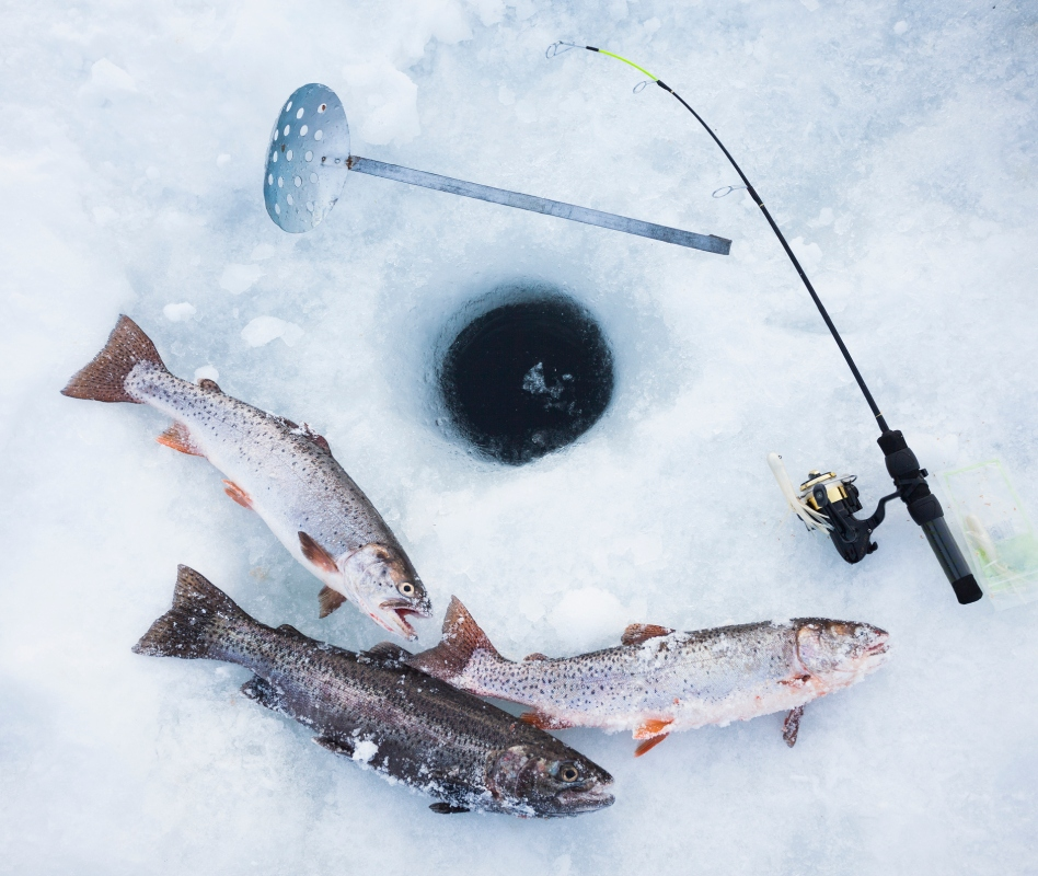 Ice fishing hole, fishing rods and trout. Stock photo. (Getty)