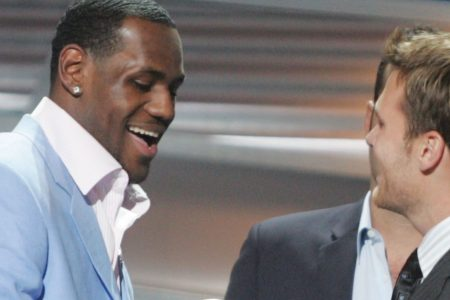HOLLYWOOD - JULY 14:  Winner for Best Breakthrough athlete, basketball player LeBron James is greeted on stage by quarterback Tom Brady at the 12th Annual ESPY Awards held at the Kodak Theatre on July 14, 2004 in Hollywood, California.  This year's ESPY's will air Sunday, July 16th on ESPN beginning 9 PM EST/6 PM EST.  (Photo by Carlo Allegri/Getty Images)
