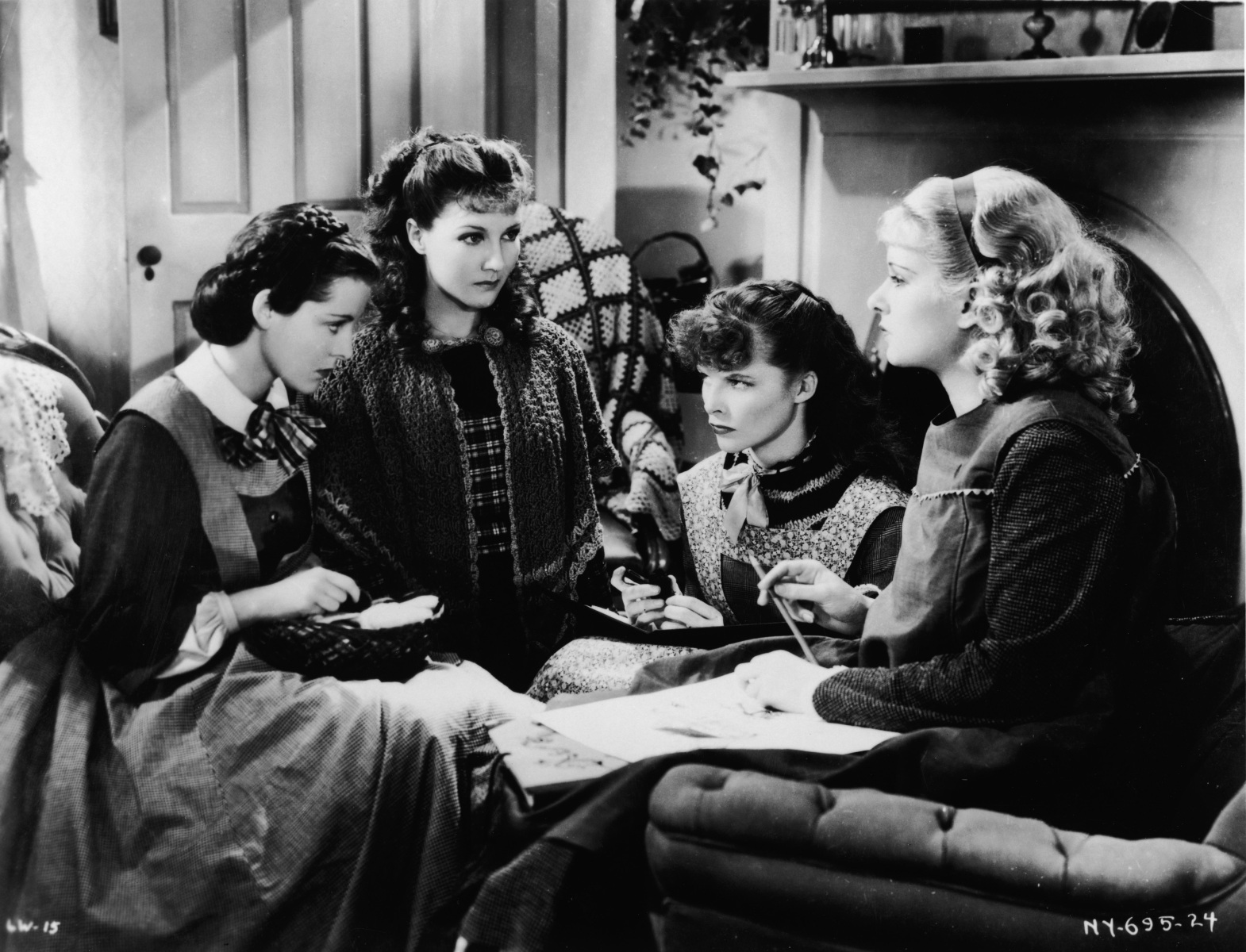 American actresses (left to right) Frances Dee (1909 - 2004), Jean Parker, Katharine Hepburn (1907 - 2003), and Joan Bennett (1910 - 1990) sit and glare at one another as the March girls in this still from a film adaptation of Louisa May Alcott's 'Little Women' directed by George Cukor, 1933. (Photo by RKO Pictures/Courtesy of Getty Images)