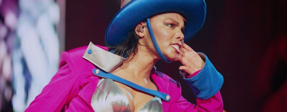 Janet Jackson performs on stage in 1998. (Photo by Phil Dent/Redferns)