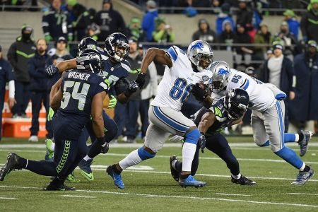 SEATTLE, WA - JANUARY 07:  Anquan Boldin #80 of the Detroit Lions runs with the ball during the first half against the Seattle Seahawks in the NFC Wild Card game at CenturyLink Field on January 7, 2017 in Seattle, Washington.  (Photo by Steve Dykes/Getty Images)