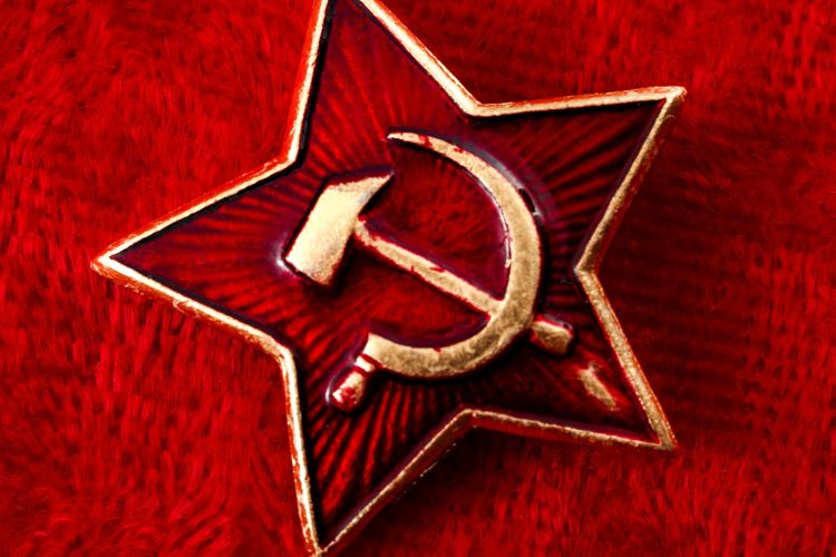 Old Soviet badge with the red star, a sickle and a hammer reminiscent of the cold war era worn by the soldiers of the Red Army on their hats. GETTY