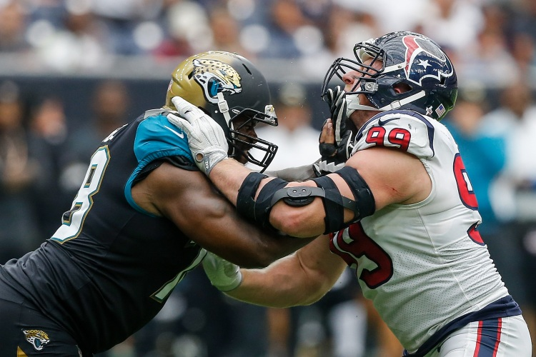 HOUSTON, TX - SEPTEMBER 10:  Jermey Parnell #78 of the Jacksonville Jaguars and J.J. Watt #99 of the Houston Texans lock up at NRG Stadium on September 10, 2017 in Houston, Texas.  (Photo by Bob Levey/Getty Images)