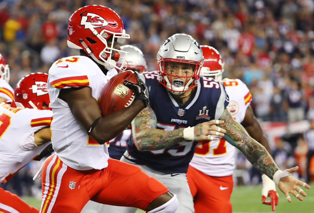 FOXBORO, MA - SEPTEMBER 07:  De'Anthony Thomas #13 of the Kansas City Chiefs runs the ball before being tackled by Cassius Marsh #55 of the New England Patriots during a game against the New England Patriots during the second half at Gillette Stadium on September 7, 2017 in Foxboro, Massachusetts.  (Photo by Adam Glanzman/Getty Images)
