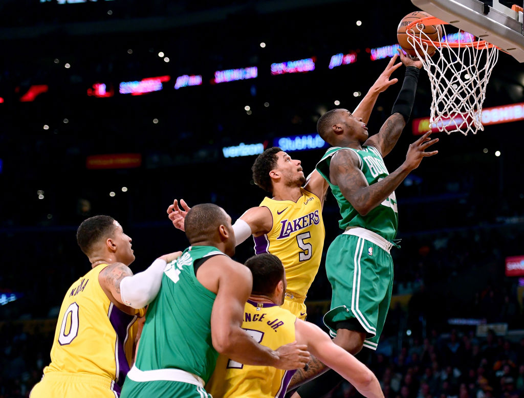 LOS ANGELES, CA - JANUARY 23:  Terry Rozier #12 of the Boston Celtics scores on a layup in front of Josh Hart #5 of the Los Angeles Lakers during a 108-107 Laker win at Staples Center on January 23, 2018 in Los Angeles, California.  (Photo by Harry How/Getty Images)
