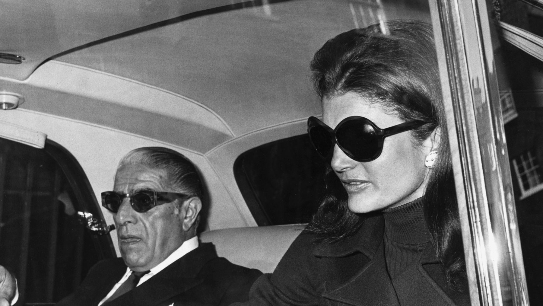 01a2369599 Aristotle Onassis with his wife Jacqueline Kennedy Onassis, just before  flying from London to Belfast