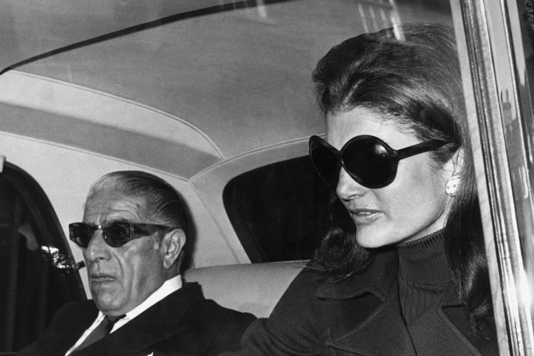 Aristotle Onassis with his wife Jacqueline Kennedy Onassis, just before flying from London to Belfast. 1970. President John F. Kennedy's widow remarried in 1968. (Hulton-Deutsch Collection/CORBIS/Corbis via Getty Images)