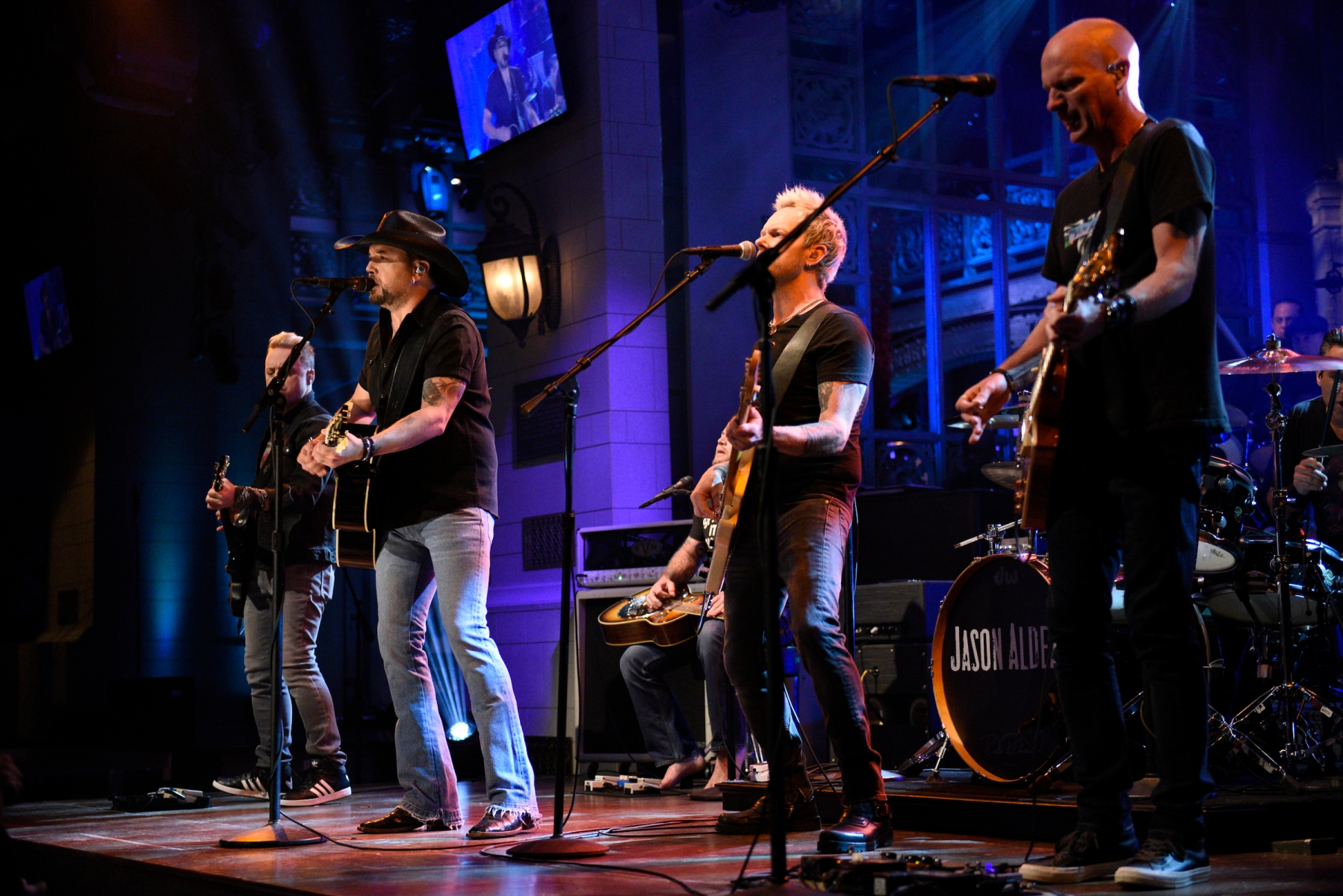 """Jason Aldean performs """"I Won't Back Down"""" in Studio 8H on October 7, 2017 to honor the victims and survivors of the Las Vegas shooting. Country music has spent the past year grappling with the tragedy. (Photo by Will Heath/NBC/NBCU Photo Bank via Getty Images)"""
