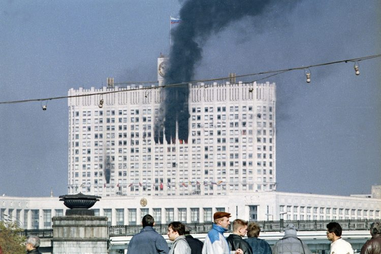 The Russian parliament building, also known as the White House, burning during the parliamentary revolt in Moscow by Communist hardliners against Boris Yeltsin. (ALEXANDER NEMENOV/AFP/Getty Images)