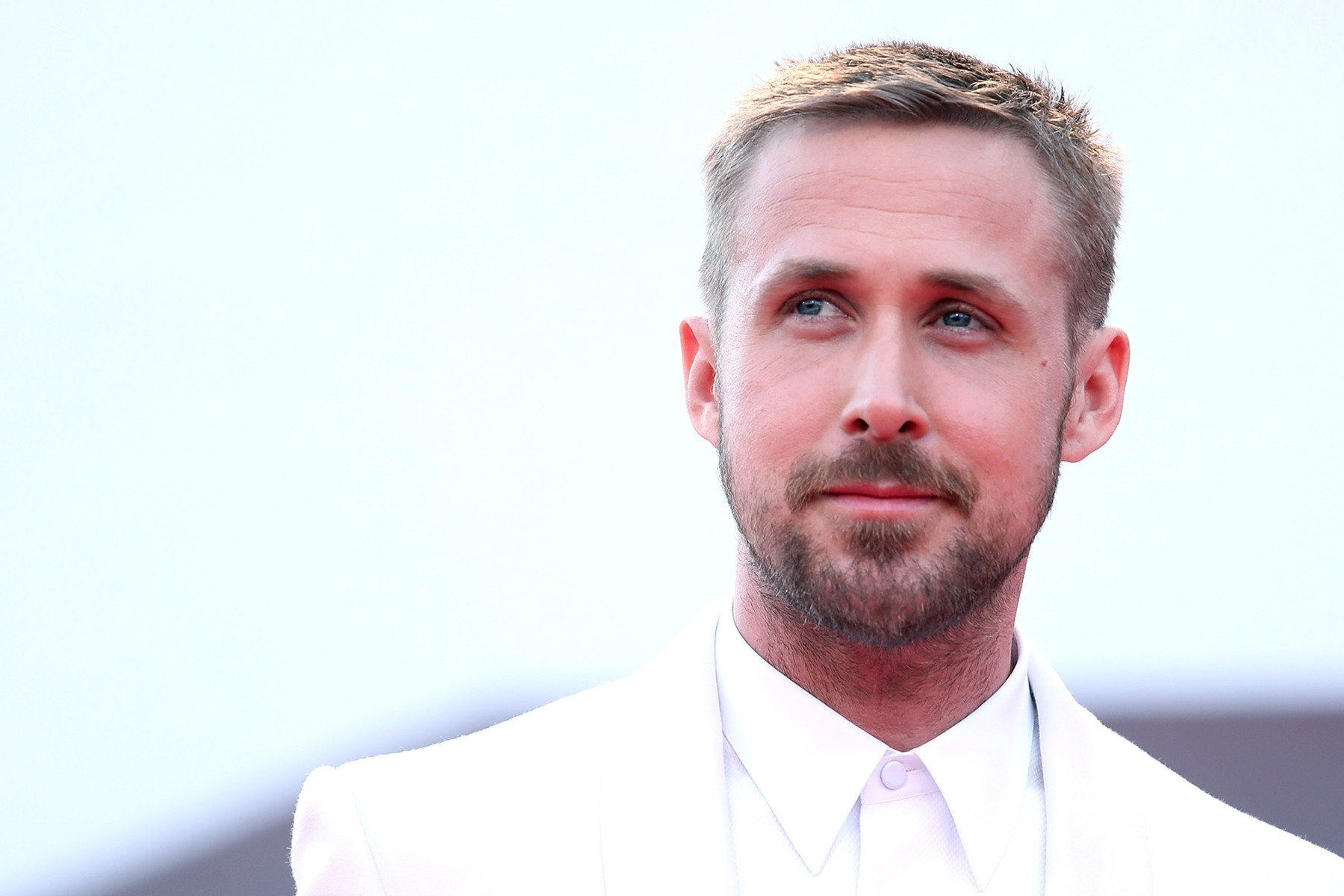 """Ryan Gosling walks the red carpet ahead of the opening ceremony and the 'First Man' screening during the 75th Venice Film Festival at Sala Grande on August 29, 2018 in Venice, Italy. Gosling developed a relationship with Neil Armstrong's two sons ahead of the filming of """"First Man."""" (Photo by Maria Moratti/Contigo/Getty Images)"""
