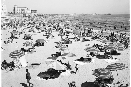 General views of crowd at Santa Monica beach, Santa Monica, California, April 13, 1958. Nick Gabaldón Day now celebrates the contributions of black surfers in California to combatting racism on the beaches. (Photo by USC Libraries/Corbis via Getty Images)