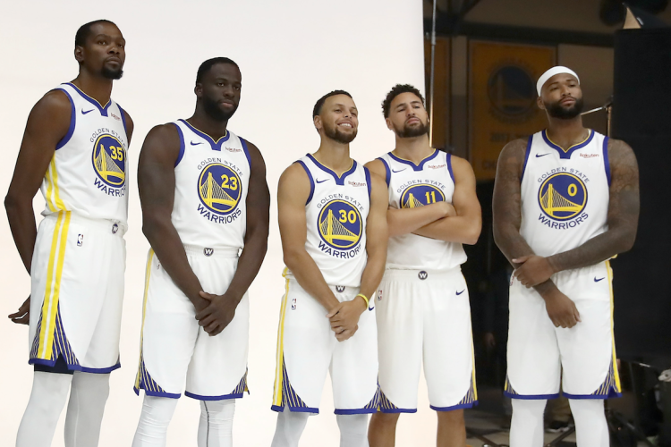 OAKLAND, CA - SEPTEMBER 24: (L-R) Kevin Durant #35, Draymond Green #23, Stephen Curry #30, Klay Thompson #11, and DeMarcus Cousins #0 of the Golden State Warriors pose for a group picture during the Golden State Warriors media day on September 24, 2018 in Oakland, California. (Photo by Ezra Shaw/Getty Images)