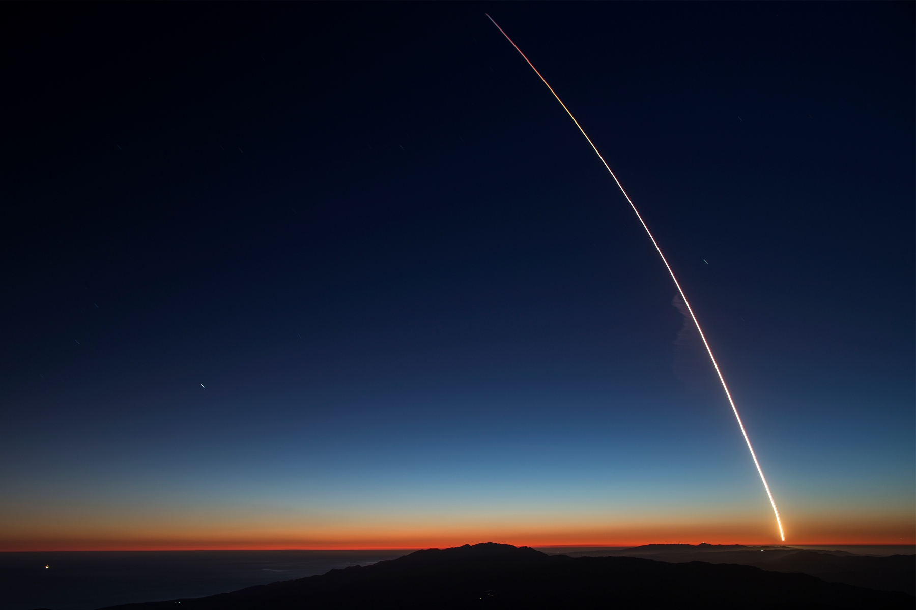 The SpaceX Falcon 9 rocket launches from Vandenberg Air Force Base carrying the SAOCOM 1A and ITASAT 1 satellites, as seen during a long exposure on October 7, 2018 near Santa Barbara, California. After launching the satellites, the Falcon 9 rocket successfully returned to land on solid ground near the launch site rather than at sea. (Photo by David McNew/Getty Images)