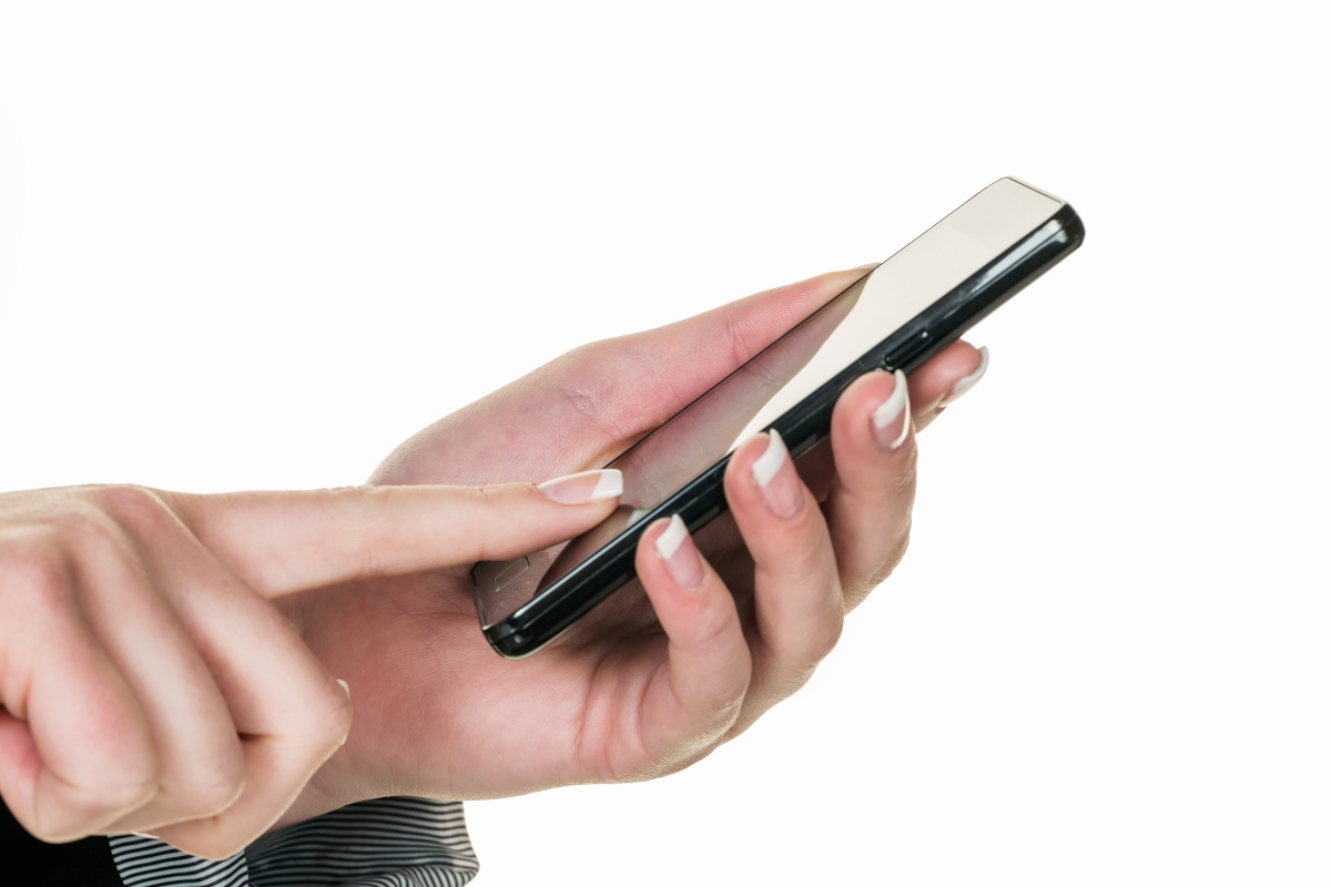 An iPhone in an user's hand. Apple recently took out a patent for a technology that would better detect and prevent spam calls. (Photo by Wodicka/ullstein bild via Getty Images)