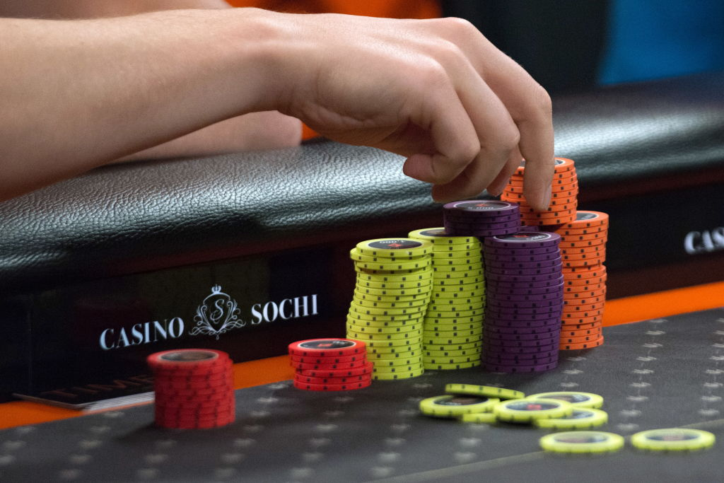 SOCHI, RUSSIA - AUGUST 10, 2018: A person with poker chips during a poker round as part of the Millions Russia poker tournament with the record-breaking guaranteed prize pool of $9 million, at the Sochi Casino and Resort. Artur Lebedev/TASS (Photo by Artur LebedevTASS via Getty Images)