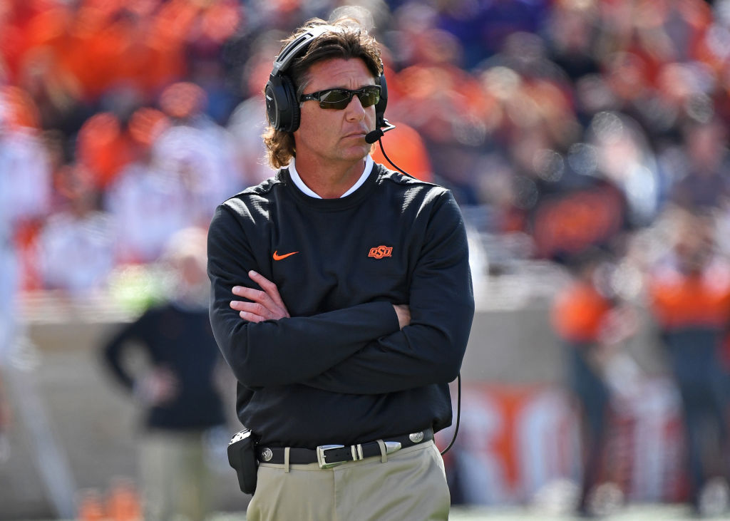 13a0c7159725 Oklahoma State coach Mike Gundy on the sideline. (Peter G. Aiken/Getty