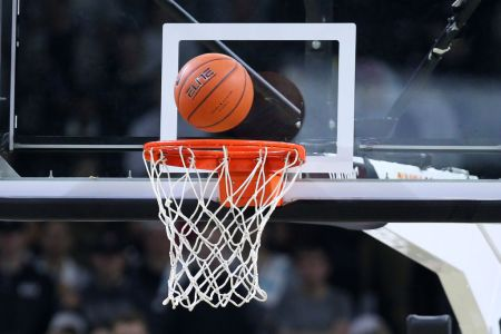 PROVIDENCE, RI - NOVEMBER 06: A general view of the game ball on the rim during a college basketball game between Siena Saints and Providence Friars on November 6, 2018, at the Dunkin Donuts Center in Providence, RI. (Photo by M. Anthony Nesmith/Icon Sportswire via Getty Images)