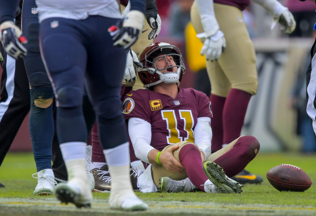 Washington Redskins quarterback Alex Smith (11) reacts to an injury in the third quarter during a game between the Washington Redskins  and the Houston Texans at FedEX Field on November 18, 2018, in Landover, MD. (Photo by John McDonnell/The Washington Post via Getty Images)