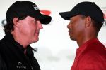 Pro golfers Phil Mickelson and Tiger Woods
