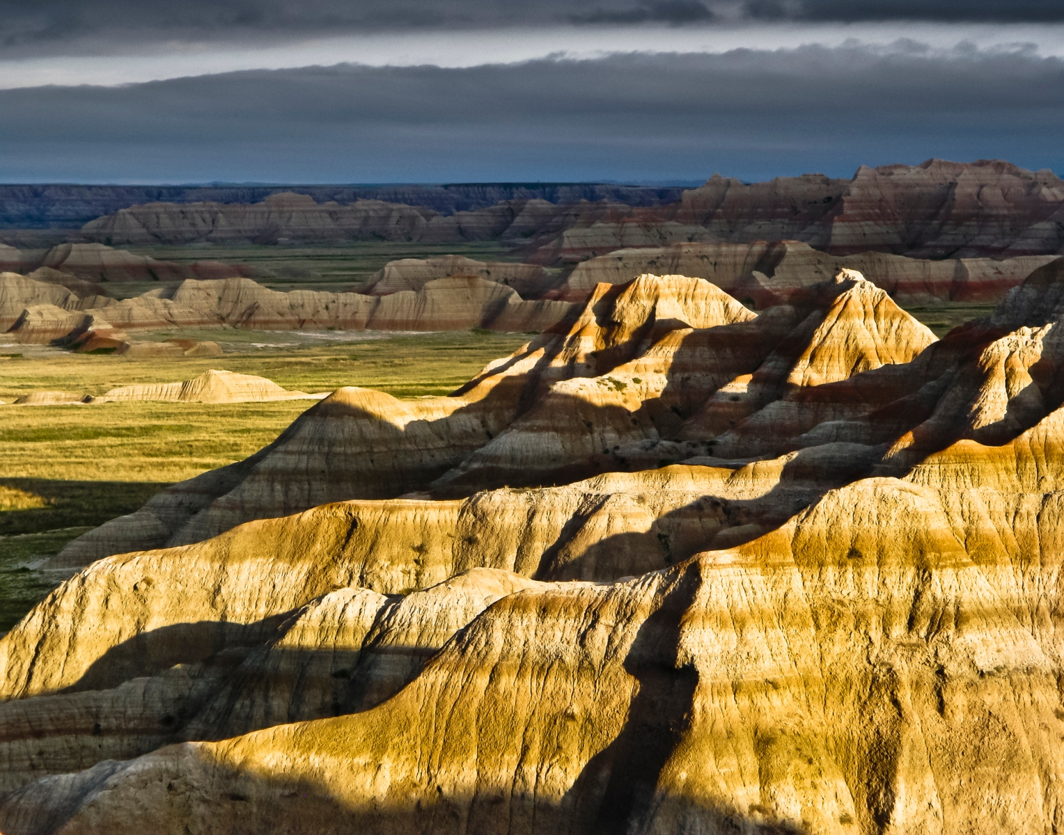 Distant clouds made for interesting background against a lightened foreground.  Morning sunrise shadows added a little extra to the mood.  Badlands National Park. Finalist in The Nature Conservancy's 2010, 5th Annual Digital Photo Contest (Getty)