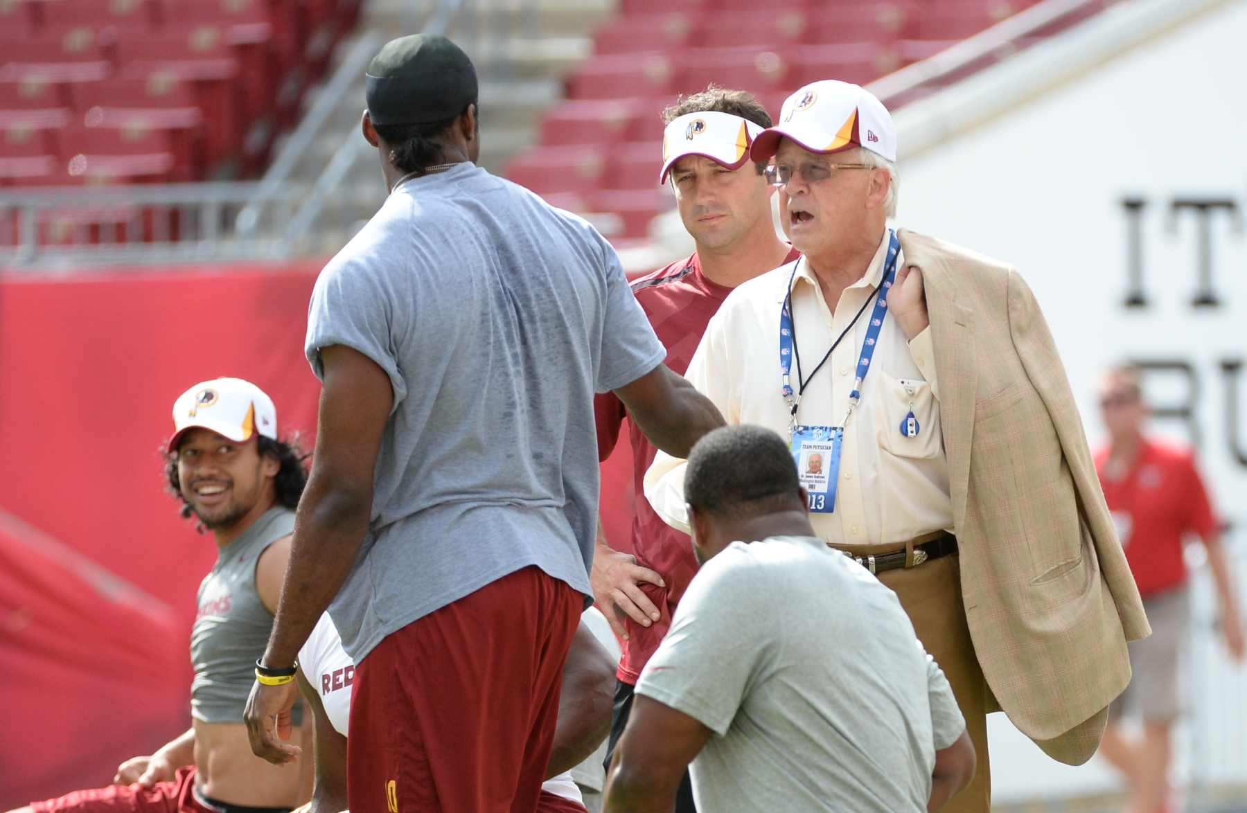 TAMPA, FL  August  29:  Dr. James Andrews talks with Washington Redskins quarterback Robert Griffin III (10) prior to action against the Tampa Bay Buccaneers on August 29,  2013 in Tampa, FL   (Photo by Jonathan Newton / The Washington Post via Getty Images)