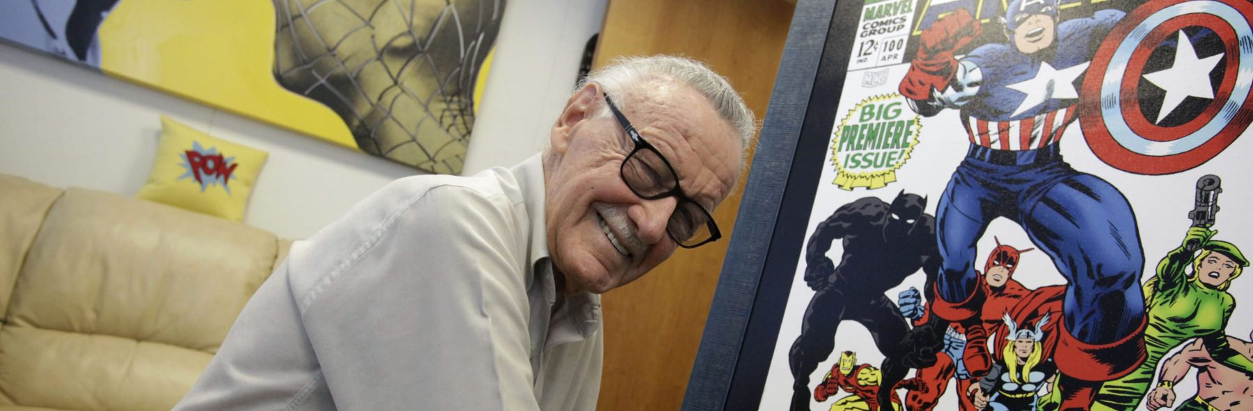 Stan Lee pictured signing poster for an exhibit in his Beverly Hills office in 2009.  (Photo by Barbara Davidson/Los Angeles Times via Getty Images)