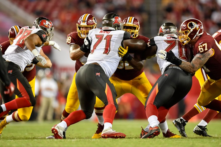 TAMPA, FL - AUGUST 31: Washington Redskins wide receiver Levern Jacobs (88) and Washington Redskins offensive lineman Ronald Patrick (62) block Tampa Bay Buccaneers defensive end Channing Ward (71) during an NFL preseason football game between the Washington Redskins and the Tampa Bay Buccaneers on August 31, 2017, at Raymond James Stadium in Tampa, FL. (Photo by Roy K. Miller/Icon Sportswire via Getty Images)
