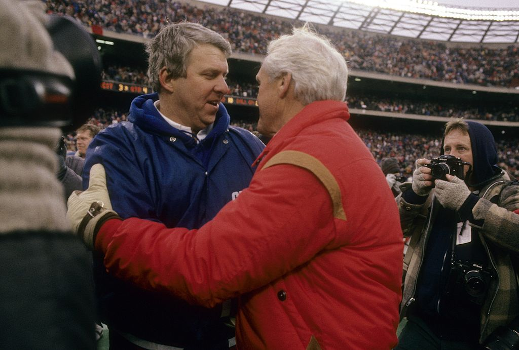 NY Giants coach Bill Parcells (L) shakes hands with the 49ers' Bill Walsh back in the mid-1980s. (Focus on Sport/Getty Images)