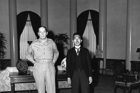 Emperor Hirohito is received by General Douglas MacArthur, U.S. commander of the Japanese occupation, at the U.S. embassy in Tokyo. The Emperor is attired in morning clothes for this precedent-shattering visit. September 1945. (Photo by © CORBIS/Corbis via Getty Images)